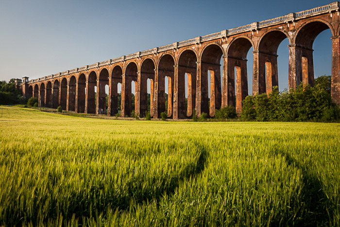 A photo of a viaduct containing leading lines to draw in the viewers attention